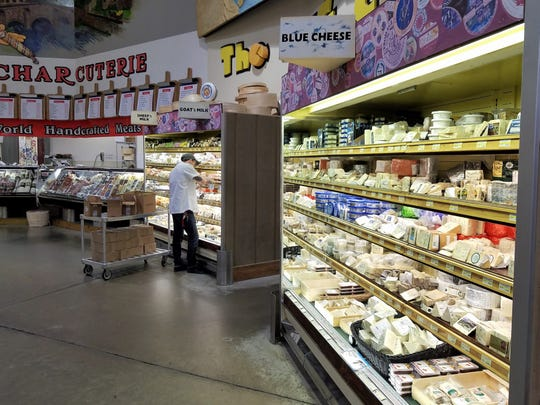 These are Jungle Jim's cheese cases housing the blue, sheep and goat cheeses. Add about a dozen more for the remainder.
