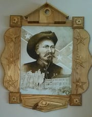 "Chuck ""Chaz"" Kuehn's new millennium tramp art includes clocks and picture frames."