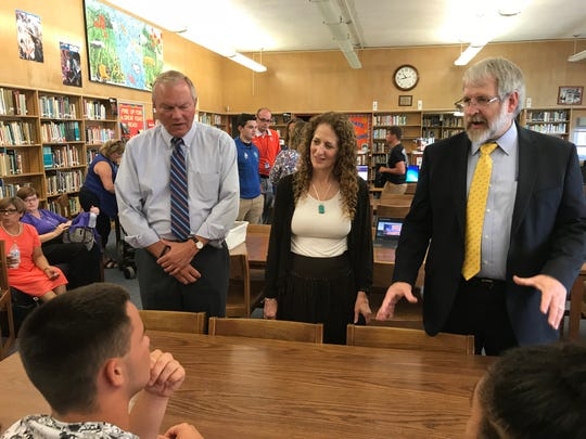 State Rep. Bill Reineke, R-Tiffin, left, with Linda Haycock, Ohio State Board of Education District 1, middle, and Paolo DeMaria, Ohio Department of Education Superintendent, right, meet with Ross High students to discuss college readiness programs.