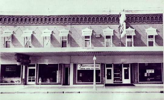A 1970s photos of the Van Atta's Restaurant and at right the Faunce's Furniture. At present,  the store on the left is empty and the other is the  Oak Harbor Family Eyecare.