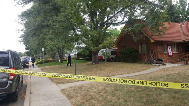Loveland police officers begin clearing the scene of a fatal shooting in the 3000 block of North Duffield Avenue Tuesday morning.