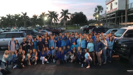 "A group of friends Tuesday morning met before school to honor Hayden Schreyer,  all wearing blue for his nickname ""Blueberry"""