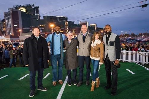 """ESPN's """"Monday Night Countdown"""" on-air personalities pose with Good Karma Brands' Craig Karmazin from the backyard of the Tundra Trio in 2017. The show is returning in October."""