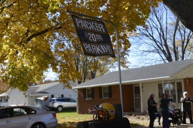 Sign advertising Packers game parking at a home near Lambeau Field.