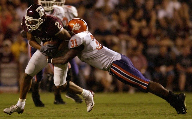 Clemson's David Dunham tackles Texas A&M's Earvin Taylor during the fourth quarter Sept. 18, 2004, at Kyle Field in College Station, Texas