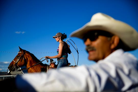 A female contestant waits to rope a calf during a practice run for a rodeo competition on the Blackfeet Indian Reservation in Browning in July.