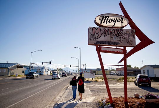 A couple walks through the main business district on the Blackfeet Indian Reservation in Browning. Browning is the heart of the Blackfeet Nation, a distinctly Western town.