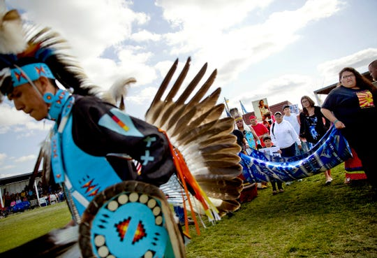 Friends and family members of Ashley HeavyRunner Loring hold a traditional blanket dance before the crowd at the North American Indian Days in Browning this past summer.