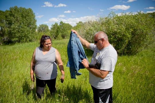 George A. Hall, right, holds up a jacket found with Lissa Loring, during a search in Valier Loring's cousin, Ashley HeavyRunner Loring, who went missing last year.