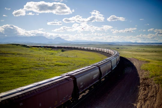 A train rounds a bend while traveling across the landscape of the Blackfeet Indian Reservation in Browning in July. Tribal police and investigators from the federal Bureau of Indian Affairs serve as law enforcement on reservations.