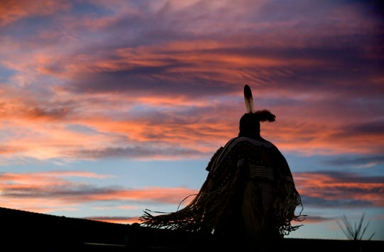 """A woman performs a traditional Native American dance during the North American Indian Days celebration on the Blackfeet Indian Reservation in Browning in July. North Dakota Democratic Sen. Heidi Heitkamp says Native American women are often subject to high rates of violence. """"It becomes a population that you can prey on,"""" she said."""