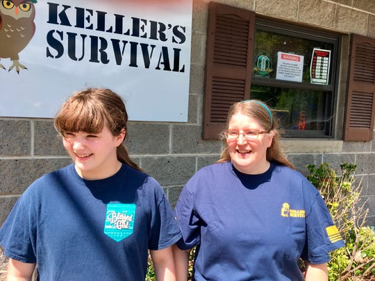 Doris Keller, right, and her daughter, Annabeth Keller, talk outside their camping supply store Thursday, Aug. 23, 2018, in Cross Lanes, W.Va. Doris Keller said she likes President Donald Trump's plan to roll back pollution controls on coal-fired power plants, even though she lives near one. President Donald Trump picked West Virginia where he announced rolling back pollution rules for coal-fired power plants. But he didn't mention that the northern two-thirds of West Virginia, with the neighboring part of Pennsylvania, would be hit hardest.  (AP Photo/John Raby)