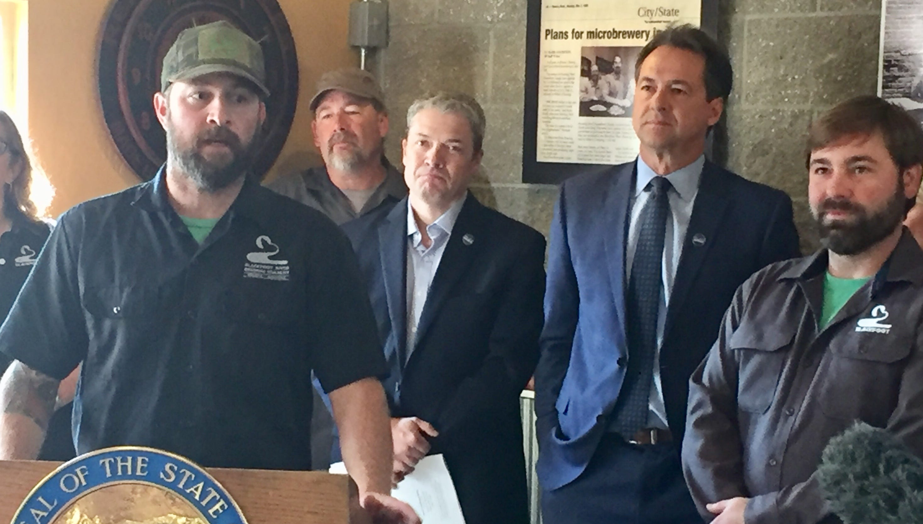 Nicholas Blacken of Blackfoot River Brewing Co., at podium, talks Monday about an apprenticeship program for brewers his company will participate in.