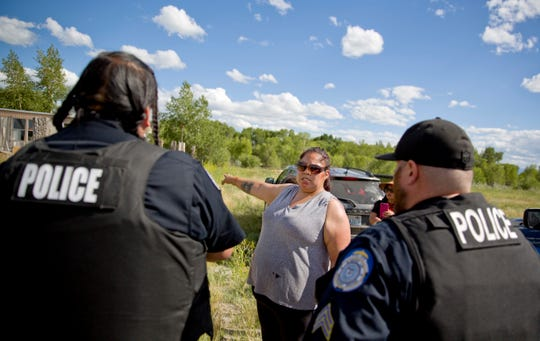 Lissa Loring points Blackfeet law enforcement officers to a trailer in Valier, Mont., where she believes clues have been found during a search for her cousin, Ashley HeavyRunner Loring, who went missing last year from the Blackfeet Indian Reservation.