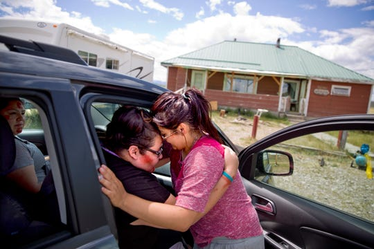 -Kimberly Loring, left, touches her forehead to her little sister, Jonnilyn, 17, as she says goodbye before heading out on a search for their missing sister Ashley.