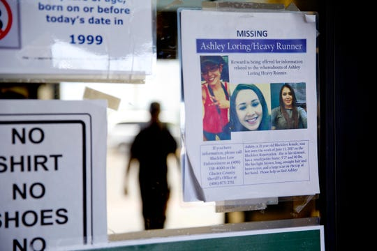 A missing poster for Ashley HeavyRunner Loring is posted to the entrance of a grocery store on the Blackfeet Indian Reservation in Browning. At first, her relatives say, tribal police suggested Ashley was old enough to take off on her own.