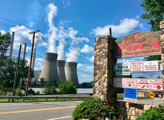 In this Aug. 23, 2018 photo, American Electric Power's John Amos coal-fired plant in Winfield, W.Va., is seen from the town of Poca across the Kanawha River. President Donald Trump picked West Virginia where he announced rolling back pollution rules for coal-fired power plants. But he didn't mention that the northern two-thirds of West Virginia, with the neighboring part of Pennsylvania, would be hit hardest.  (AP Photo/John Raby)