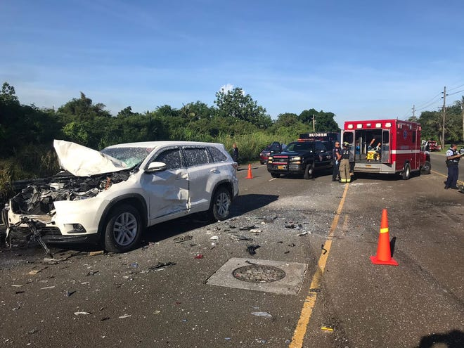 Guam Fire Department firefighters work at the scene of a three-car accident on Route 10 near Father Duenas Memorial School on Sept. 5, 2018.