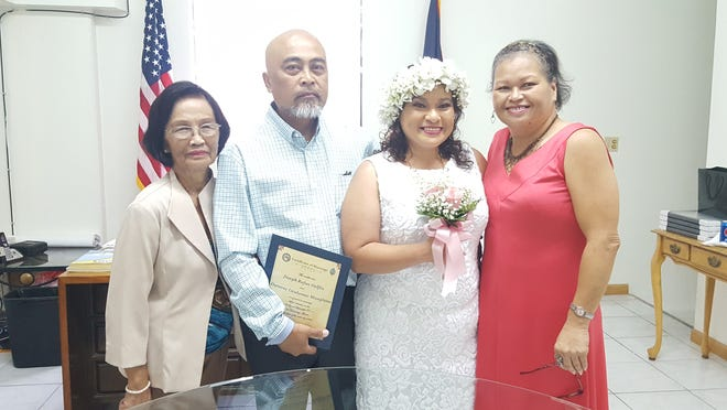 Joseph Delfin and Doreene Manglona were wed by Sen. Joe S. San Agustin Sept. 4 at his office in Tamuning. Pictured from left: Jacinta Delfin, Joseph Delfin, Doreen Manglona and Bell Hami.