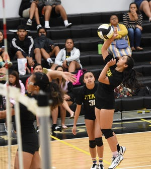 The Tiyan High Titans, shown in this Sept. 4 file photo against the Southern High Dolphins in an IIAAG High School Girls Volleyball match, will face the Academy of Our Lady of Guam Cougars in a playoff battle that's the PDN Game of the Week.