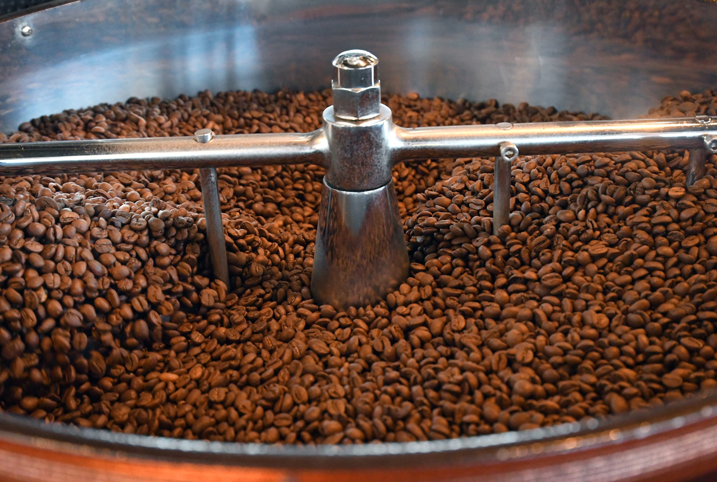 Coffee beans cool down after being roasted at Grin Coffee in Hattiesburg.