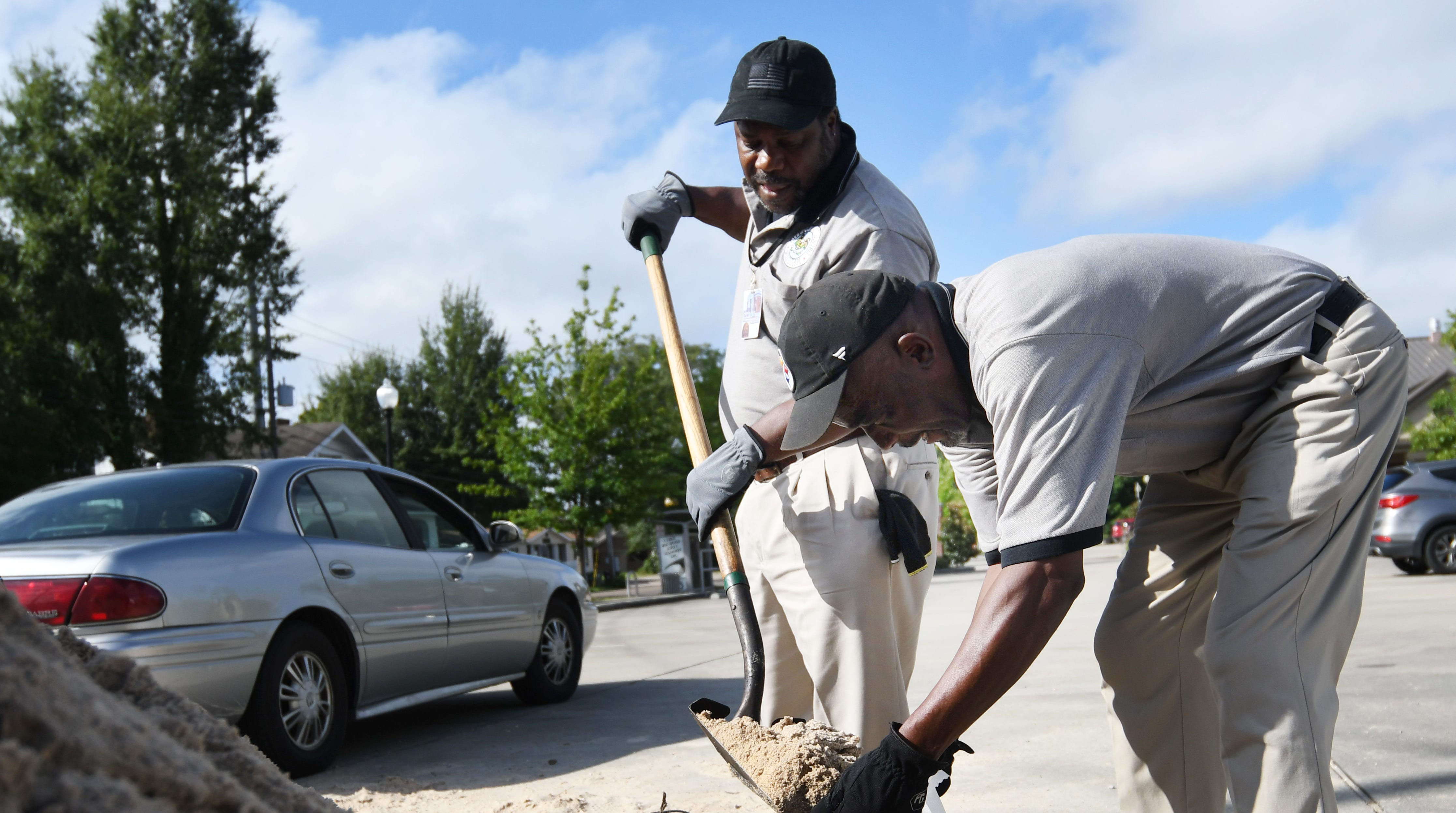 City of Hattiesburg Parks and Recreational employees Michael Means, left and Jay Hester, right, bag sand in preparation of Tropical Storm Gordon on Tuesday, September 4, 2018.