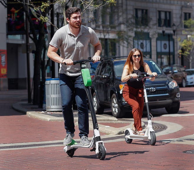 Motorized scooters in use on the streets of Indianapolis on Sept. 4, 2018.