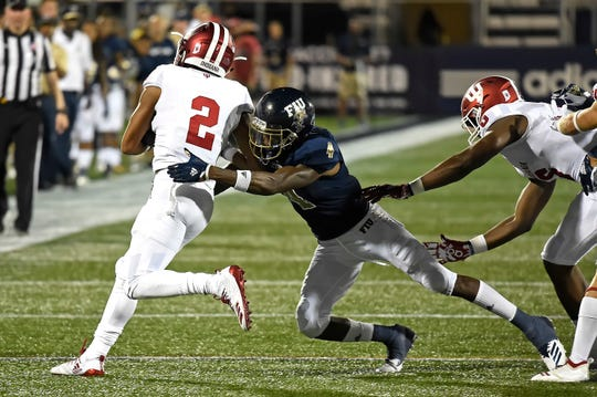Reese Taylor (2) played on both sides of the ball in Indiana's win over FIU on Saturday.
