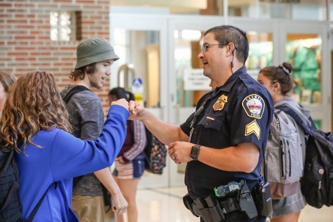 Carmel Clay Schools Resource Officer, Sgt. D.J. Schoeff, patrols the halls at the end of the school day at Carmel High School in Carmel Ind. on Thursday, Aug. 30, 2018. Schoeff has spent nearly a decade as a Carmel Clay Schools Resource Officer.