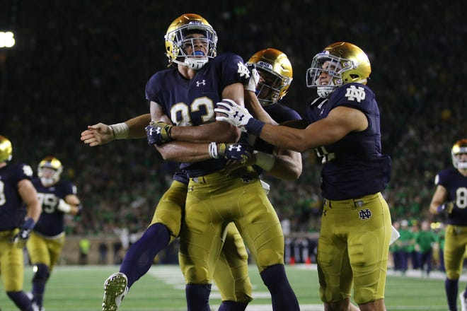 Notre Dame wide receiver Chase Claypool (83) celebrates after stopping the ball inside the 5-yard line on a kickoff against the Michigan
