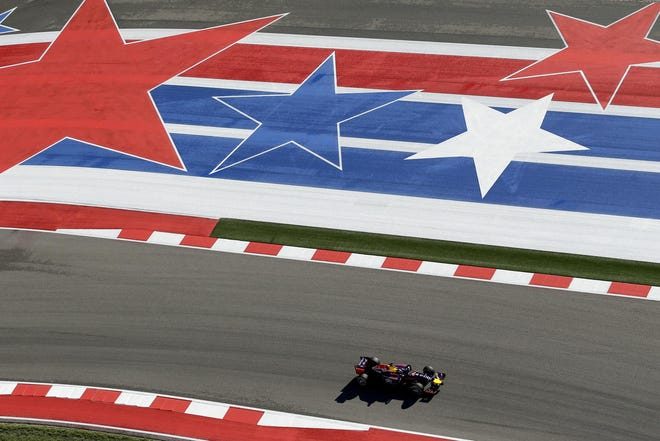 Formula One Red Bull driver Sebastian Vettel drives around Circuit of the Americas during a practice session in 2014. Indy cars will run at COTA for the first in 2019 (AP Photo/Eric Gay)