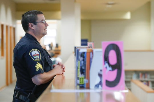 Carmel Clay SchoolsÊResource Officer, Sgt. D.J. Schoeff watches over the media center at Carmel High School in Carmel Ind. on Thursday, Aug. 30, 2018.