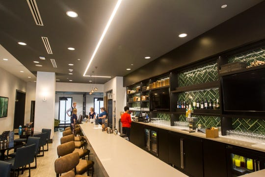 The first floor main lobby bar area is seen during a tour on Tuesday, Sept. 4, 2018, at Hyatt Place on the corner of Court and Linn Streets in downtown Iowa City.