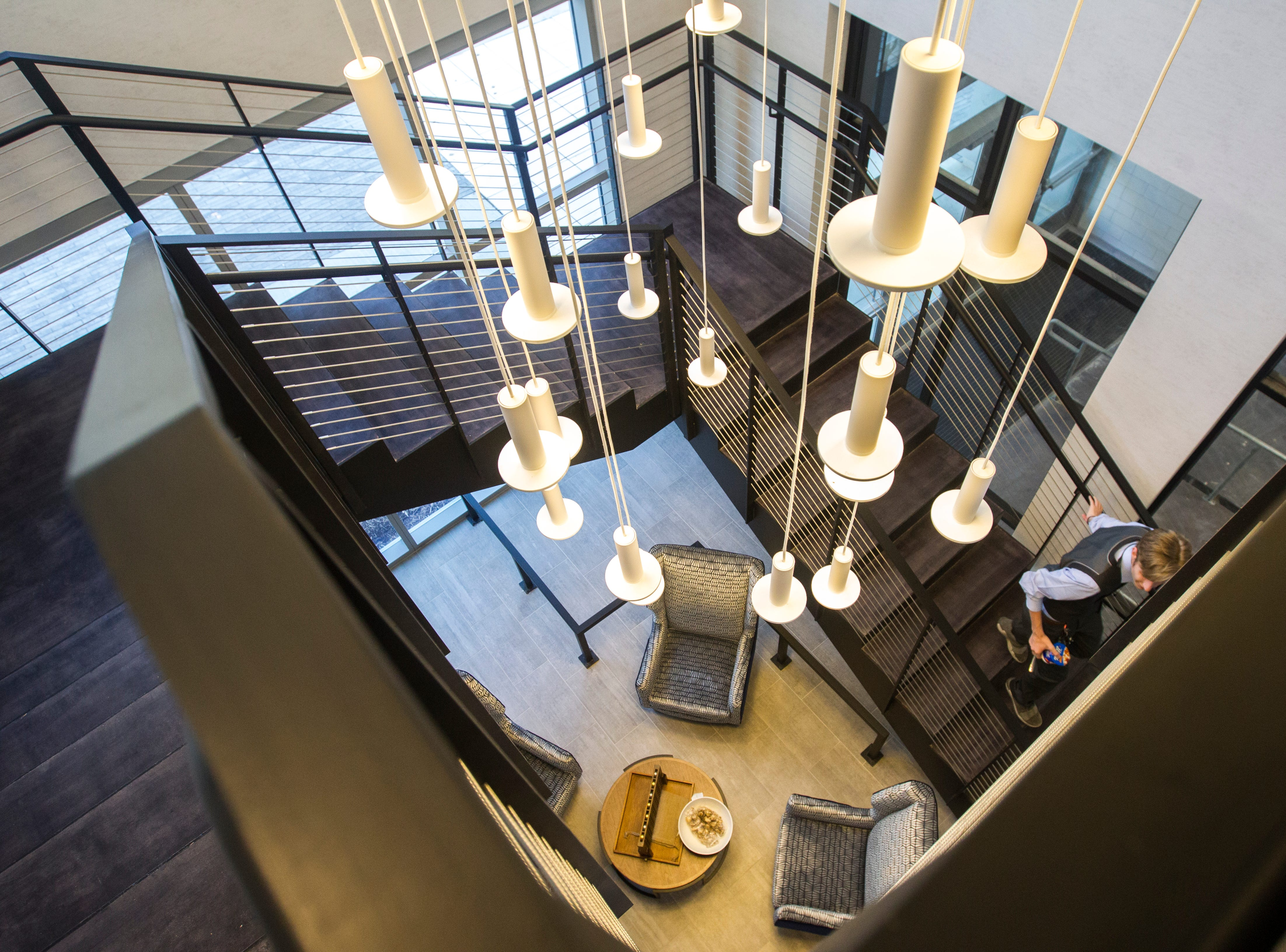 A staircase from the second floor breakfast area leads to the main lobby during a tour on Tuesday, Sept. 4, 2018, at Hyatt Place on the corner of Court and Linn Streets in downtown Iowa City.