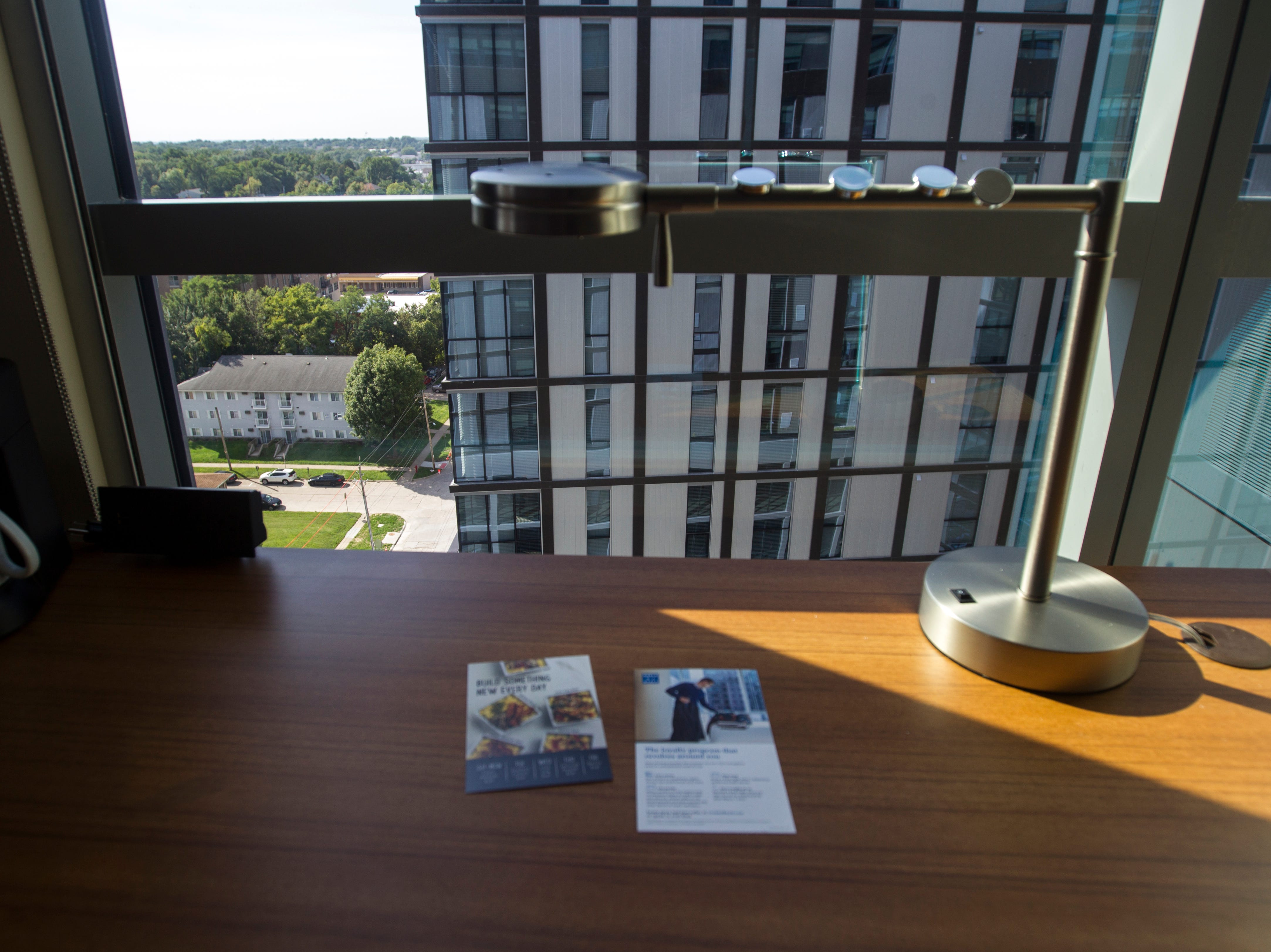 A desk overlooks a courtyard from a 10th floor room during a tour on Tuesday, Sept. 4, 2018, at Hyatt Place on the corner of Court and Linn Streets in downtown Iowa City.