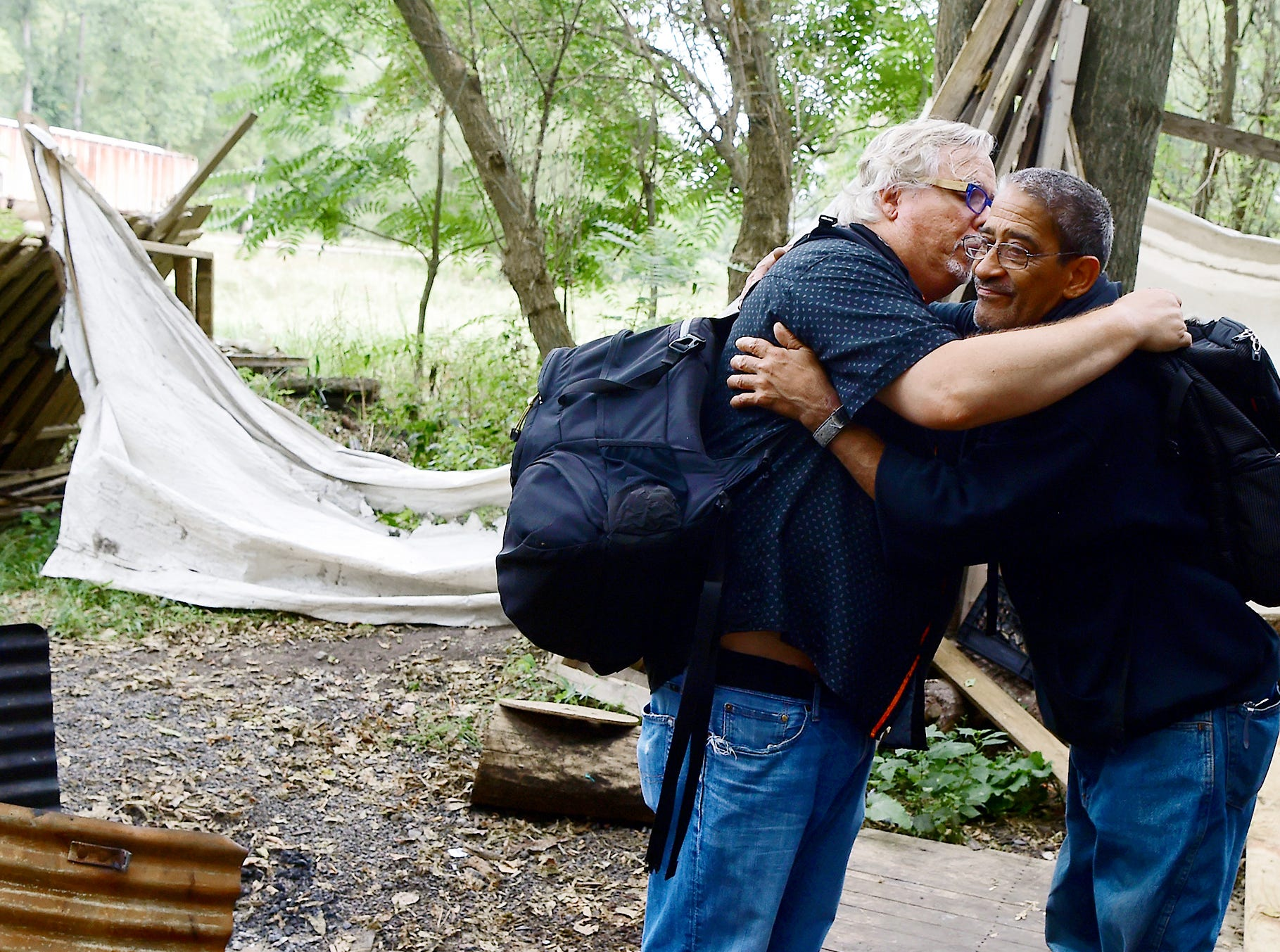 """Mark Horvath hugs Sinbad on August 31, 2018, in Ithaca's homeless encampment, """"The Jungle."""" Horvath, of Binghamton, is the founder of Invisible People, and travels worldwide to help raise awareness about homelessness."""