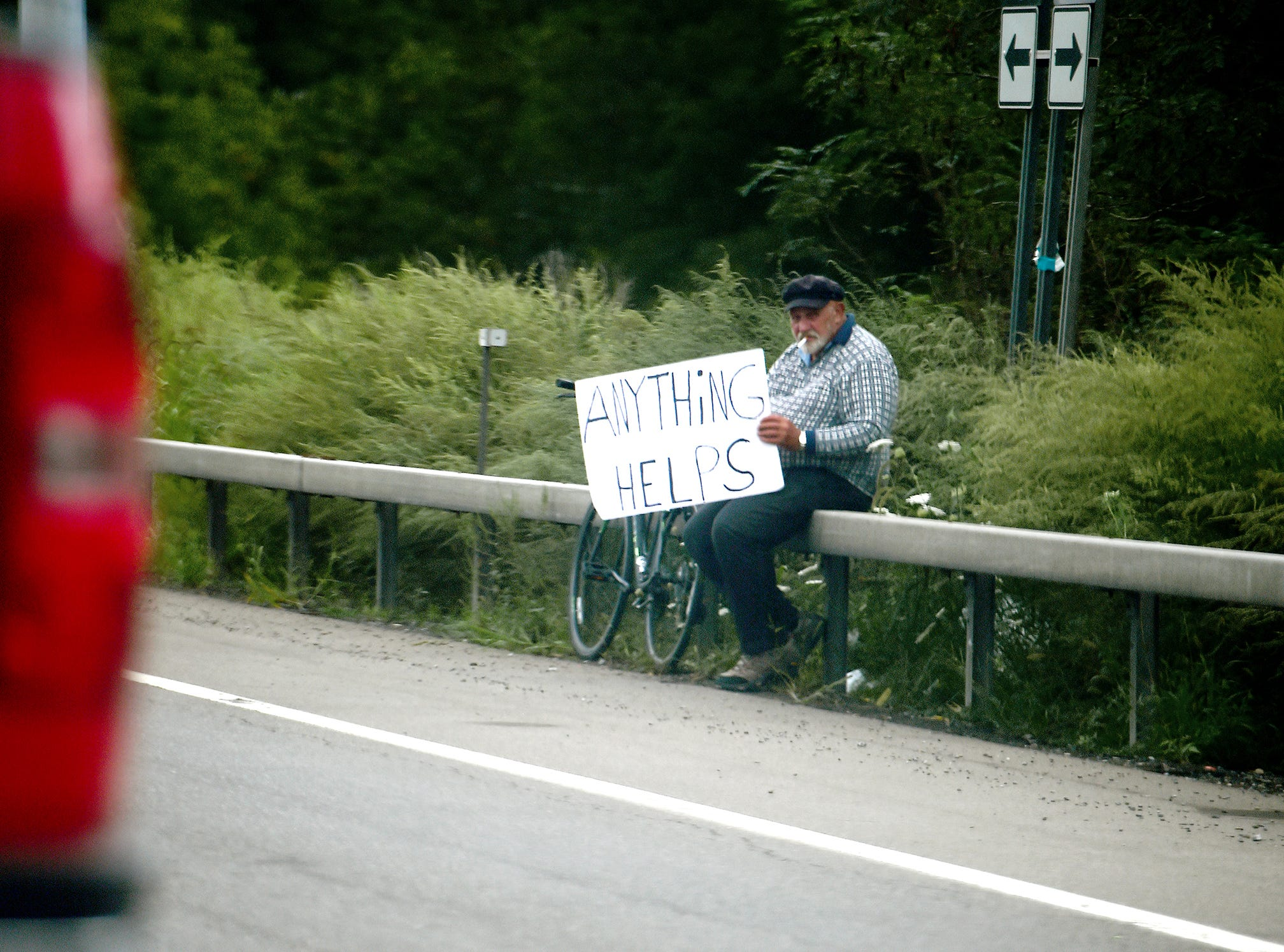 A man panhandles along Rt. 13 in Ithaca, August 31, 2018.