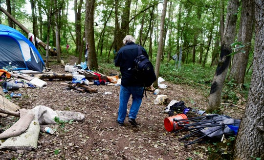 Mark Horvath walks through The Jungle, Ithaca's homeless encampment, on August 31, 2018. Horvath, of Binghamton, is the founder of Invisible People, and travels worldwide to help raise awareness about homelessness.