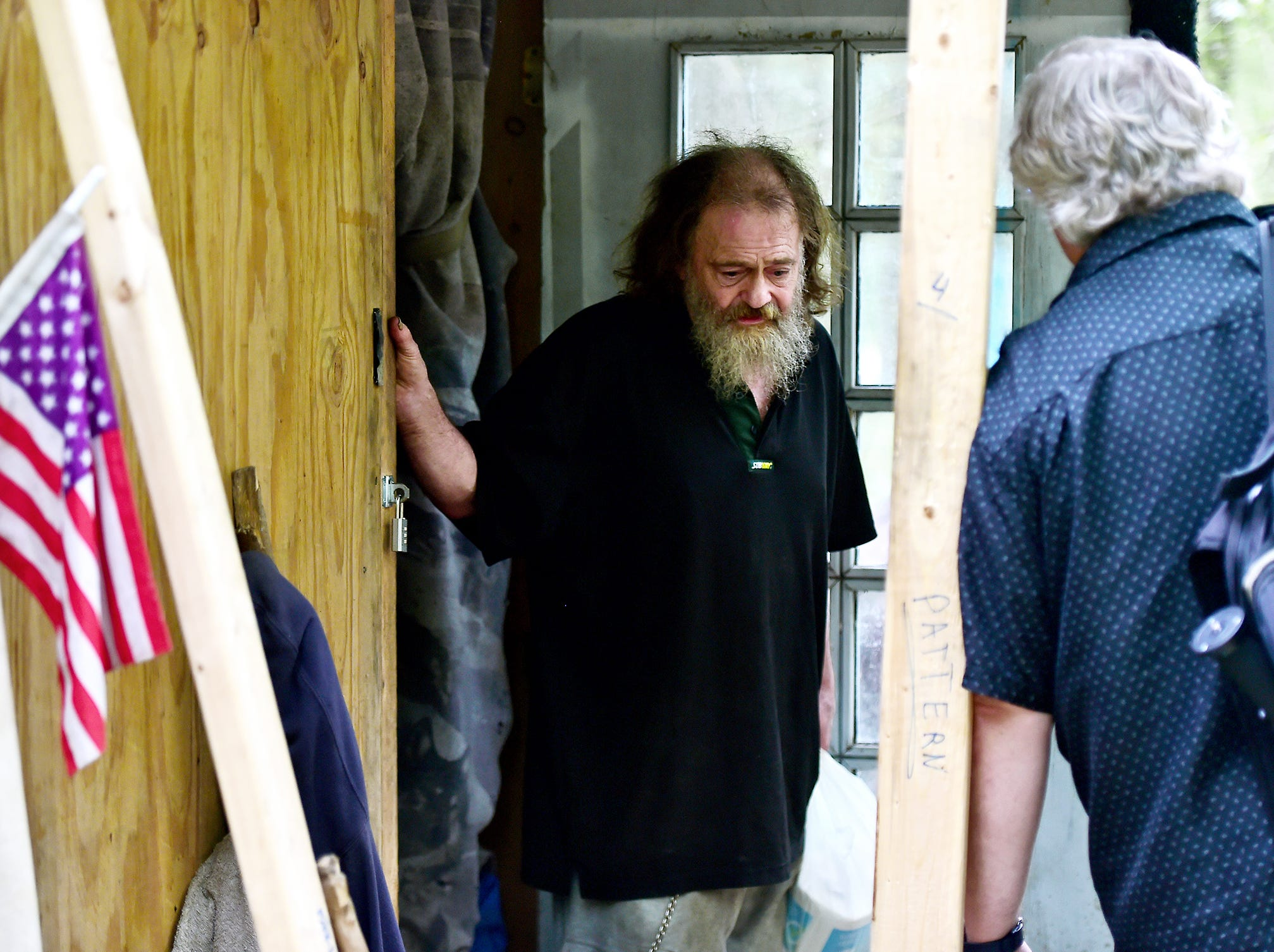 Mark Horvath, left, interviews Bill, who lives in The Jungle in Ithaca, on August 31, 2018. Horvath is the founder of Invisible People, an organization which seeks to raise awareness by empowering homeless people worldwide tell their stories.