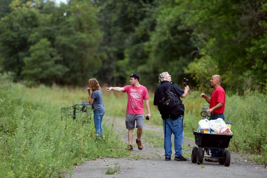 Noah and Deb Wilke, of Horseheads, Mark Horvath of Binghamton, and Carmen Guidi of Newfield, deliver essential supplies including water, toilet paper and bug repellant, to The Jungle in Ithaca on August 31, 2018. Located behind the shopping centers along Rt. 13, The Jungle is home to dozens of homeless people.