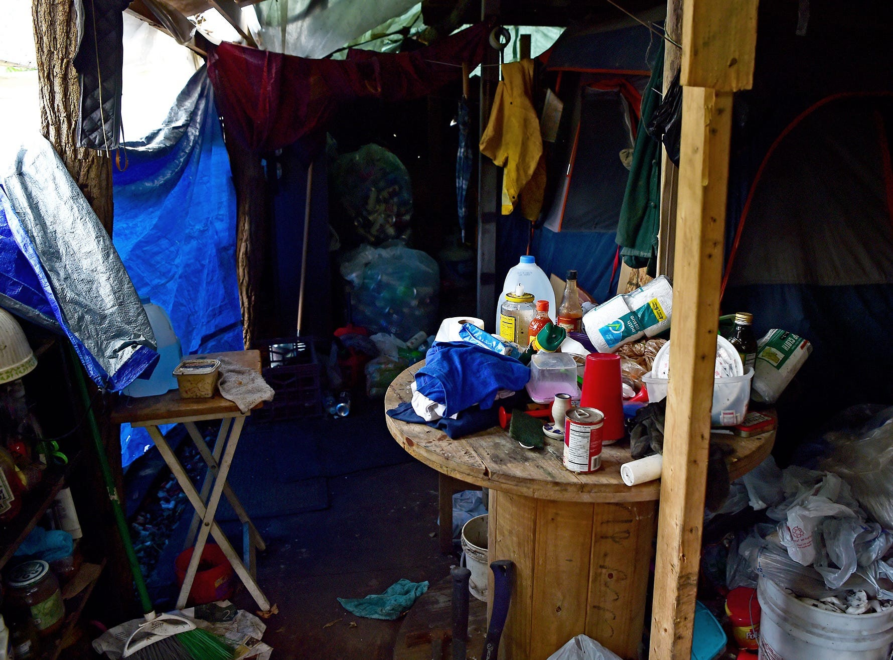"""Inside the structure which serves as home for a resident of """"The Jungle"""" in Ithaca, August 31, 2018. Carmen Guidi and other volunteers often provide supplies and help homeless people build shelters in The Jungle, which is located behind the shopping centers on Rt. 13."""