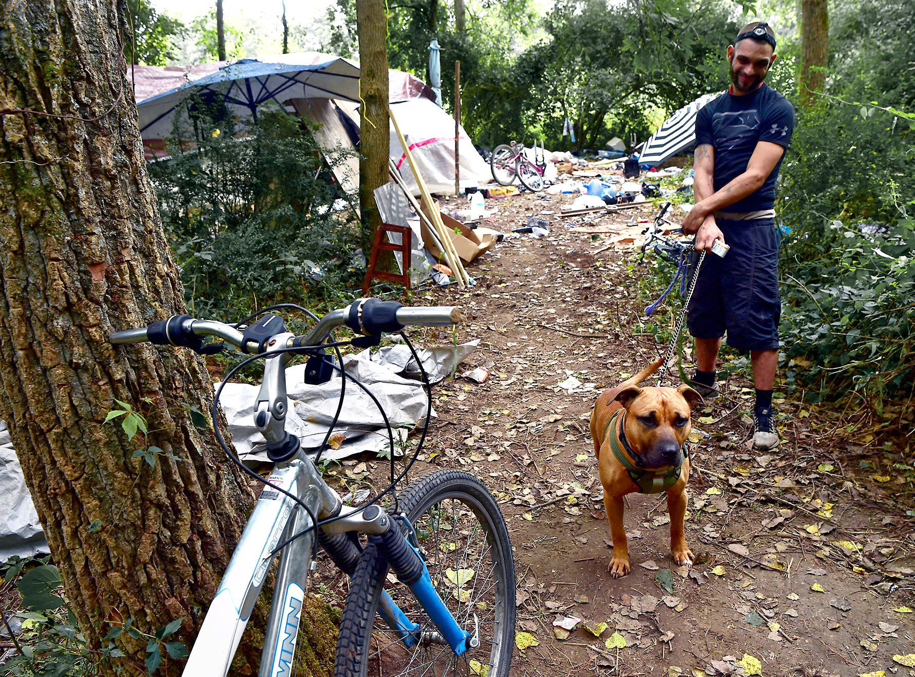 A resident of The Jungle in Ithaca with his dog Scooby. Located behind the shopping centers along Rt. 13, The Jungle is home to dozens of homeless people who live in tents and makeshift shacks.