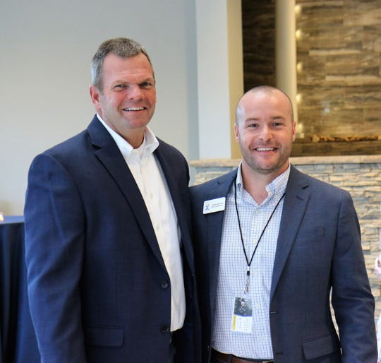 Jackson Christian President Mark Benton and Director of Advancement Blake Beckham pose for a photo during a reception for donors Aug. 28, 2018, before the musical group Anthem Lights took the stage for a fundraising concert on the school's campus in Jackson.
