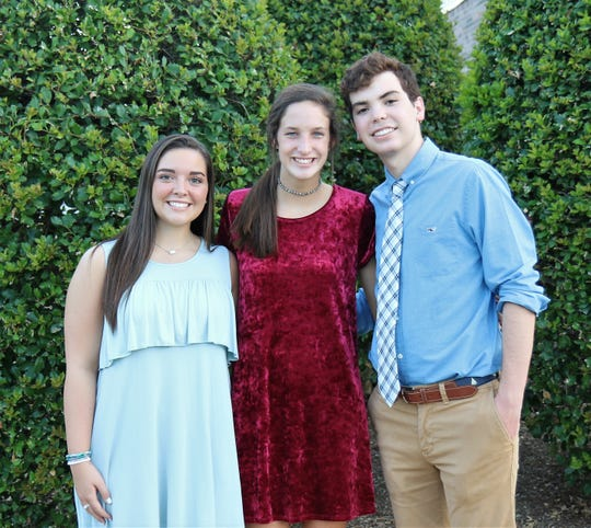 Jackson Christian students Kendall Murphy, Faith Harlan and Trevor Wilson greet guests Aug. 28, 2018, at the fundraising concert with the musical group Anthem Lights on the school's campus in Jackson.