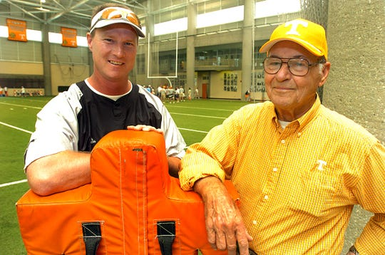 UT football coach Randy Sanders, left, and his father, R.L. Sanders, right.     6/17/2005