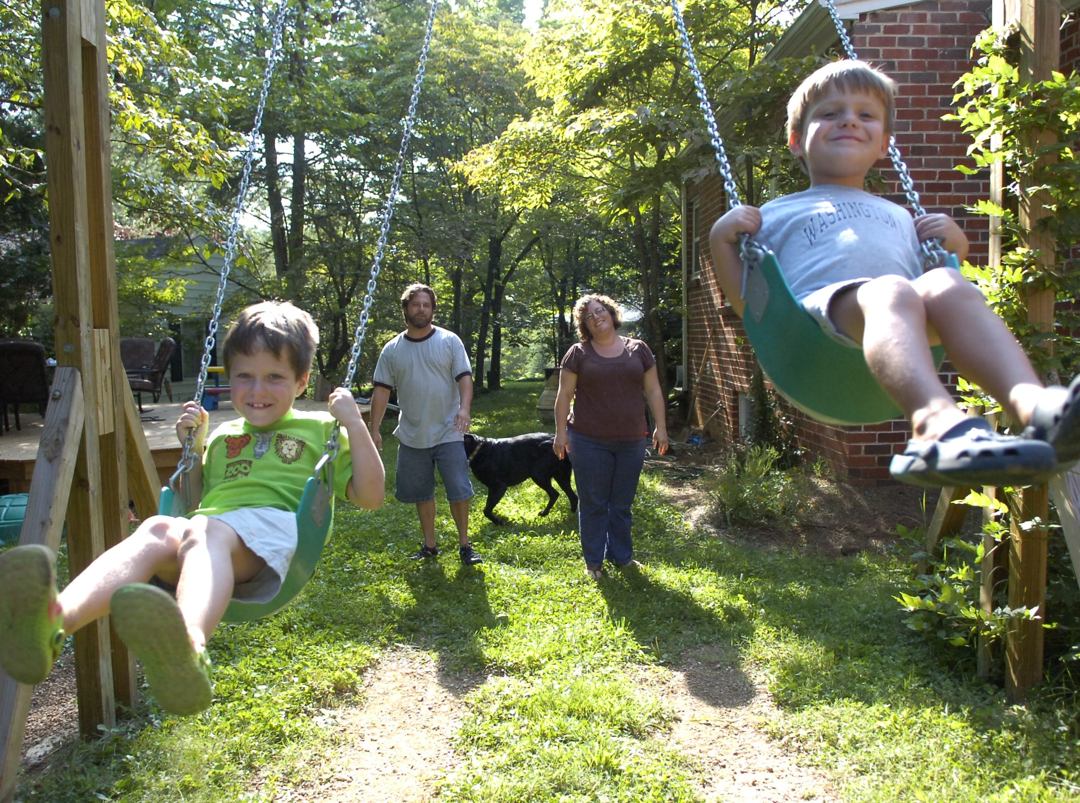 Steve and Tammy Sommers (cq) with their sons Boone 6, and Braxxton (cq) 4, play on the swing set at their home in Knoxville on Friday. Tammy Sommers was wounded when Jim David Adkisson entered the Tennessee Valley Unitarian Universalist Church on with a shot gun on Sunday, July 27, 2008.