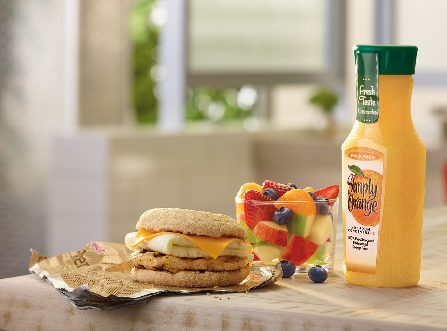 Chick-fil-A eggwhite grill with fruit and Simply Orange juice
