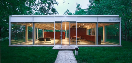 This custom-designed glass house, built by a University of Tennessee professor atop a Knoxville river cliff, will be sold to benefit the Knoxville Museum of Art.