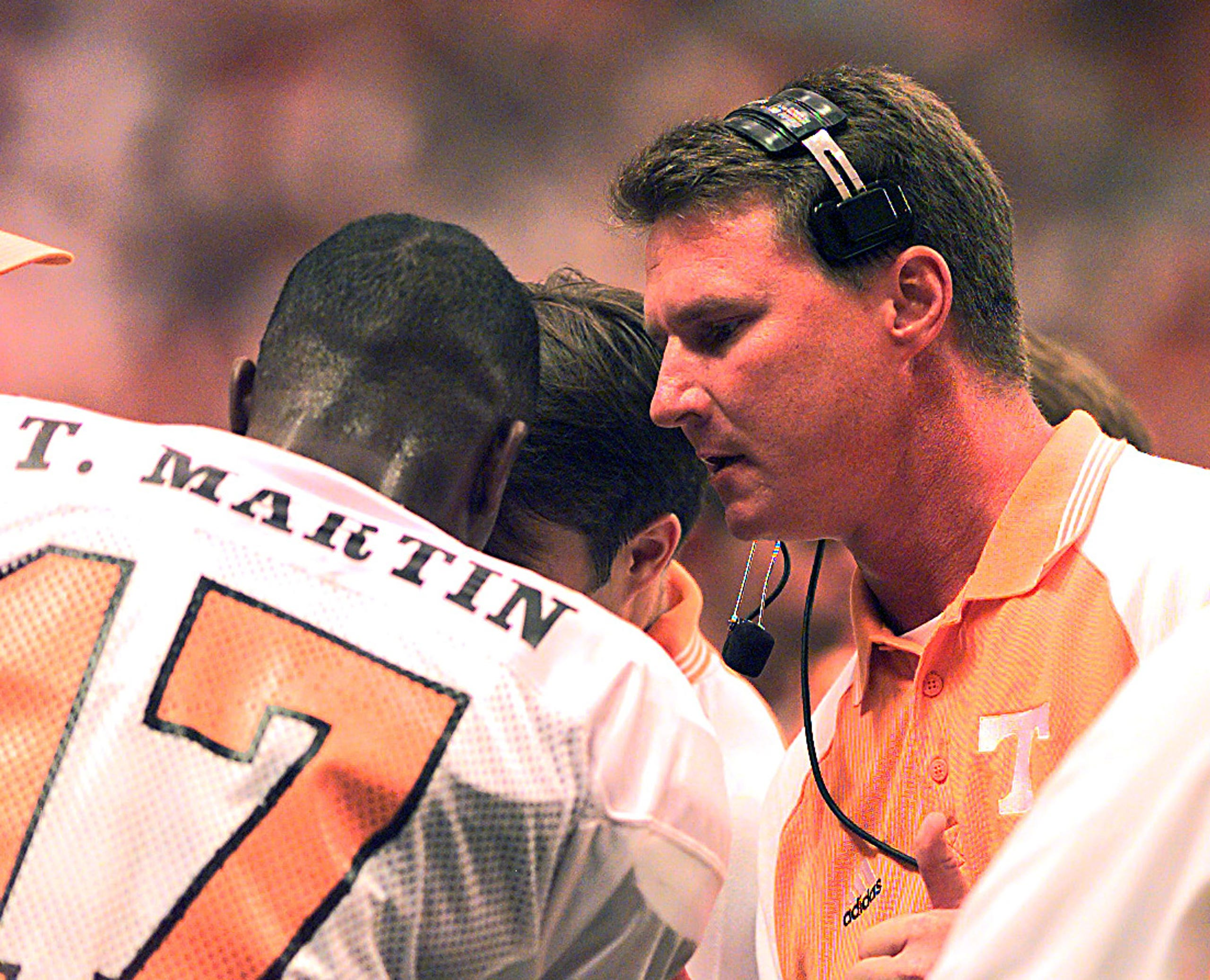 Randy Sanders talks to quarterback Tee Martin on the sidelines during action against Syracuse on Sept. 5, 1998