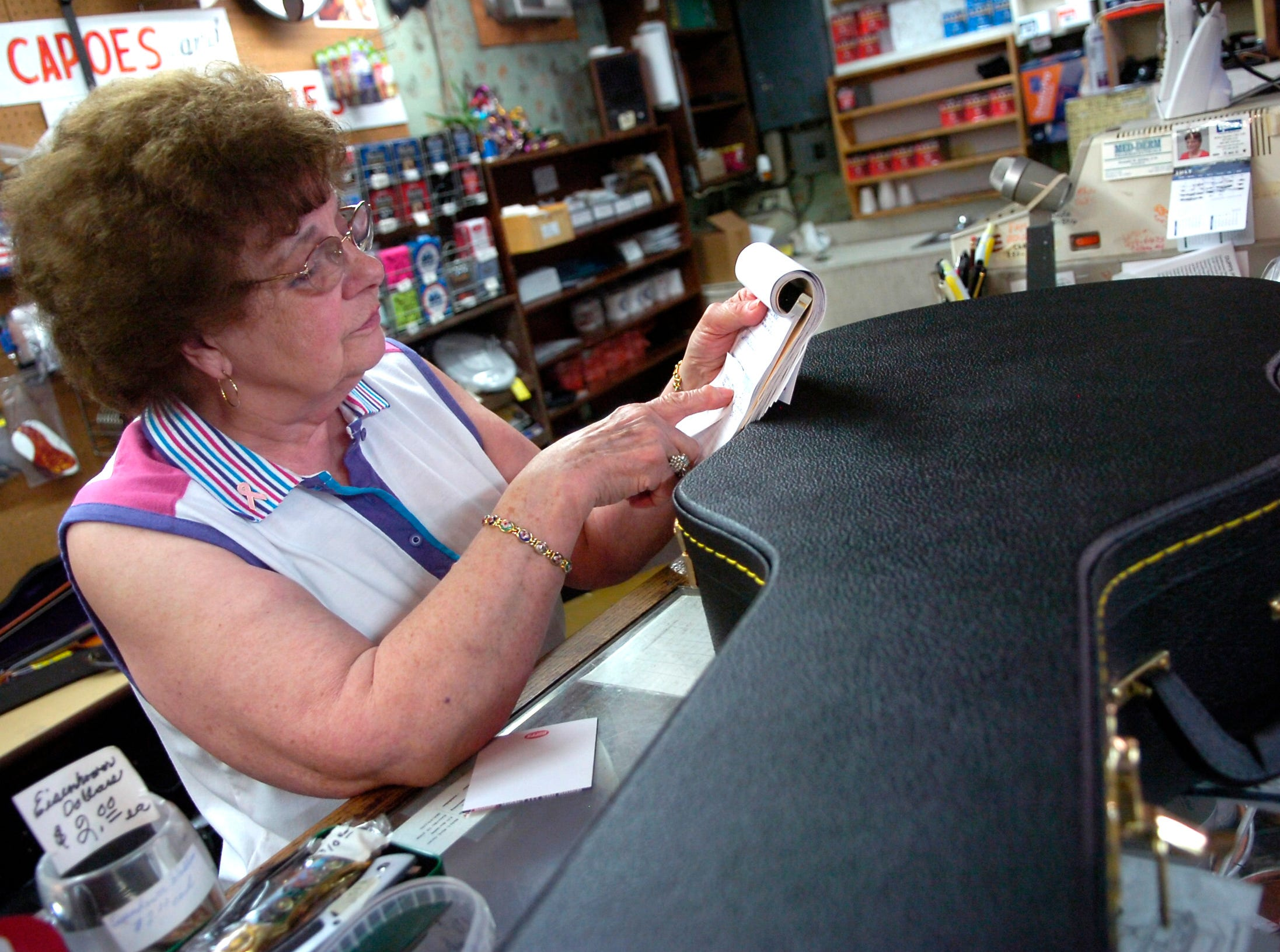 Employee Faye West shows a purchase ticket from accused shooter Jim Adkisson at the Ciderville Music Store on Clinton Highway.  Adkisson purchased a guitar case at the store last Friday which he used to conceal his weapon before the shooting at the Tennessee Valley Unitarian Universalist Church on Sunday, July, 27, 2008.